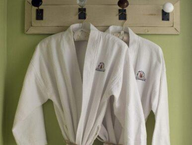 2 white robes hanging