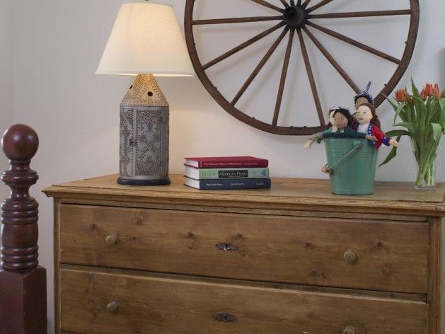 wagon wheel above dresser