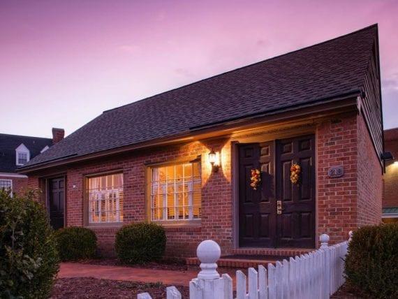 brick cottage at twilight