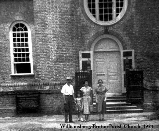 3 people standing outside of Williamsburg Bruton Parish Church