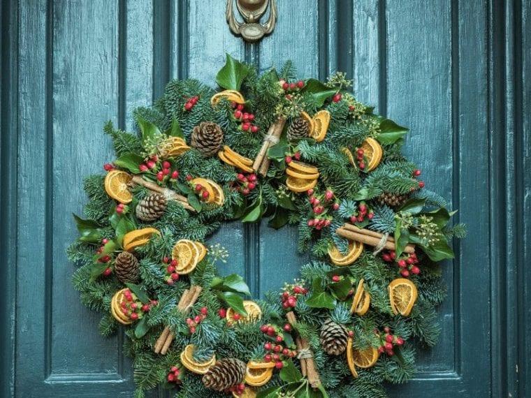 green wreath on blue door
